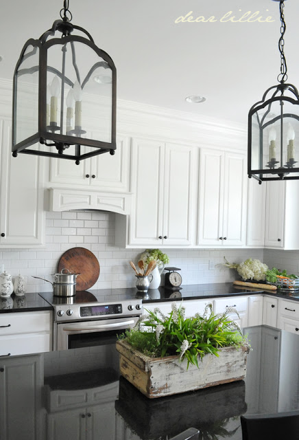 Black-Pearl-granite-with-white-cabinets-in-kitchen